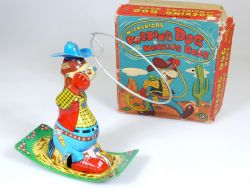 K Rocking Dog Mechanical Whirling Rope Cowboy Blech Japan OVP