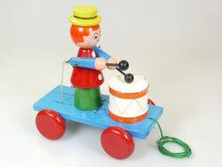 Älteres Holzspielzeug Ziehwagen mit Trommler-Clown und Blechtrommel